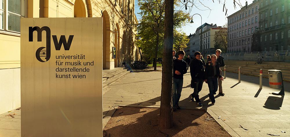 mdw students in front of mdw's main building at Anton-von-Webern-Platz 1, 1030 Vienna